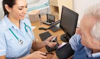 Nurse taking elderly man\'s blood pressure