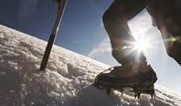 Climber on snowy mountain
