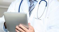 Doctor using electronic tablet device