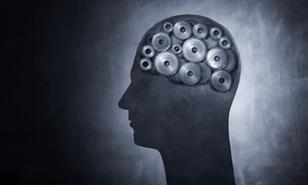 Conceptual image of head filled with cog gears