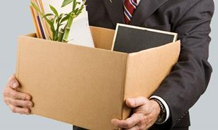 Man holding a box of office belongings
